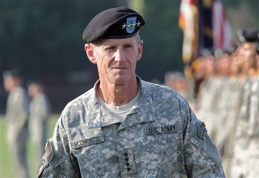 © This July 23, 2010, file photo shows Gen. Stanley McChrystal reviewing troops for the last time as he is honored at a retirement ceremony at Fort McNair in Washington.