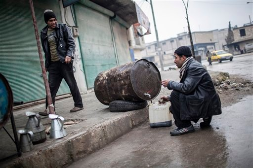  People sell fuel in the streets of Aleppo, Syria, Saturday, Jan. 5, 2013. The revolt against President Bashar Assad that started in March 2011 began with peaceful protests but morphed into a civil war that has killed more than 60,000 people.