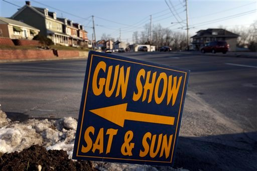 © A sign is posted for an upcoming gun show, Friday, Jan. 4, 2013, in Leesport, Pa. Gun advocates arenít backing down from their insistence on the right to keep and bear arms.