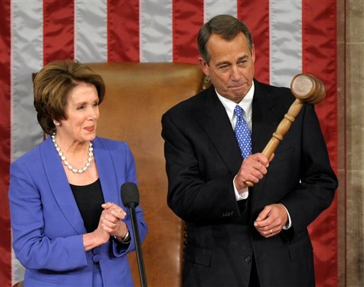© House Minority Leader Nancy Pelosi of Calif. applauds after handing the gavel to House Speaker John Boehner of Ohio who was re-elected as House Speaker of the 113th Congress, Thursday, Jan. 3, 2013, on Capitol Hill in Washington.