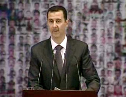 © In this image taken from video obtained from Syrian State Television, which has been authenticated based on its contents and other AP reporting, Syrian President Bashar Assad speaks at the Opera House in central Damascus, Syria, Sunday, Jan. 6, 2013.