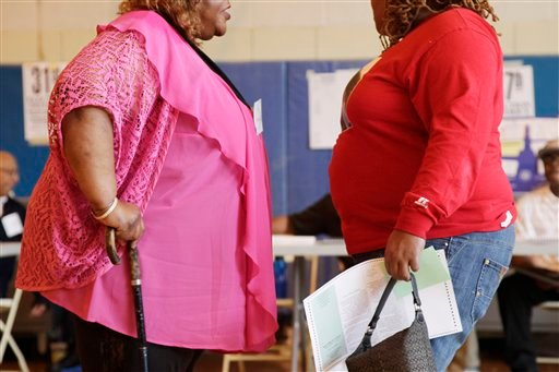 © In this June 26, 2012, photo, two overweight women hold a conversation in New York.