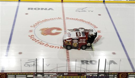 © The ice surface is cleaned at an empty Scotiabank Saddledome, home of the NHL's Calgary Flames, on Sunday, Jan. 6, 2013, in Calgary, Alberta.