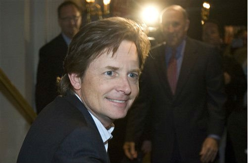 © In a Nov. 6, 2006 file photo actor Michael J. Fox greets supporters at a rally for Wisconsin Gov. Jim Doyle in Milwaukee.