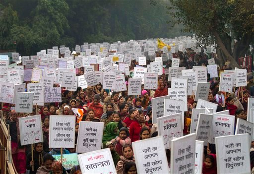 ©  In this Wednesday, Jan. 2, 2013 file photo, Indian women carry placards as they march to mourn the death of a gang rape victim in New Delhi, India.