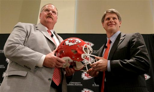 New Kansas City Chiefs NFL team head football coach Andy Reid, left, and owner Clark Hunt pose for photographers during a news conference at Arrowhead Stadium Monday, Jan. 7, 2013, in Kansas City, Mo.