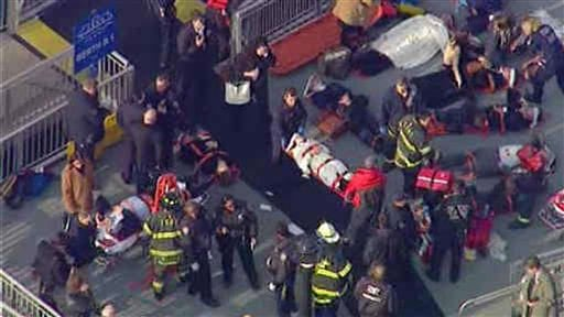 This aerial photo provided by WABC News Channel 7 shows emergency personnel at the scene of a ferry crash in Lower Manhattan, Wednesday, Jan. 9, 2013, in New York. (AP Photo/WABC News Channel 7)