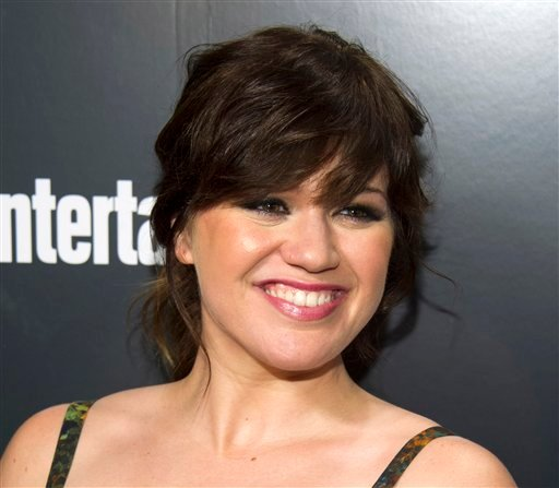 This May 15, 2012 file photo shows Kelly Clarkson attending the Entertainment Weekly and ABC Upfronts Party in New York. (AP Photo/Charles Sykes File)
