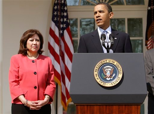 FILE - This April 15, 2010 file photo shows Labor Secretary Hilda Solis standing with President Barack Obama in the Rose Garden of the White House in Washington. Solis is telling colleagues she is leaving the Obama administration. (AP Photo)