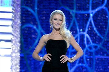 © This photo courtesy Miss America Organization shows Miss DC, Allyn Rose, during the Evening Wear portion of preliminary competition at the 2013 Miss America Pageant in Las Vegas, Tuesday, Jan. 8, 2013.