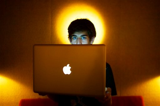  In this Jan. 30, 2009 photo, Internet activist Aaron Swartz poses for a photo in Miami Beach, Fla. Swartz was found dead Friday, Jan. 11, 2013, in his Brooklyn, N.Y., apartment, according to Ellen Borakove, spokeswoman for New York's medical examiner.
