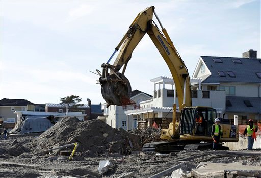 © The remains of a house damaged by Superstorm Sandy and then bulldozed by a contractor are removed from the beach in the Belle Harbor section of the Rockaways, as cleanup from the storm continues Thursday, Jan. 10, 2013, in New York.
