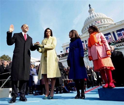 © In this Jan. 20, 2009, file photo, President Barack Obama and first lady Michelle Obama walk the inaugural parade route in Washington.