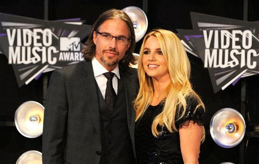 © In this Aug. 28, 2011 file photo, Jason Trawick and Britney Spears arrive at the MTV Video Music Awards in Los Angeles. A judge says Spears' one-time fiance Jason Trawick has resigned as her co-conservator on Friday Jan. 11, 2013.