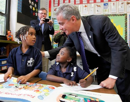 © In this Oct. 27, 2011 file photo, Chicago Mayor Rahm Emanuel, right, visits with Brandy Toliver, left, and Mariah Neyland, in their first-grade class at the CICS Washington Park School on Chicago's South Side.