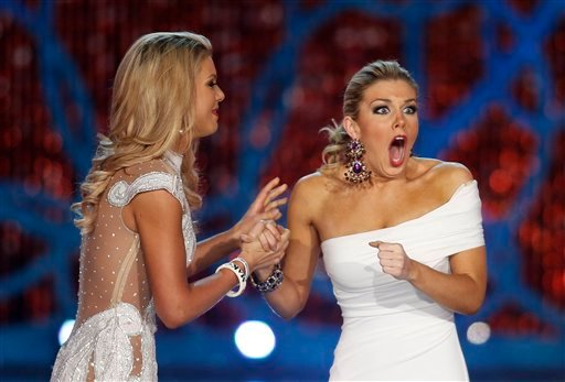 © Miss New York, Mallory Hagan, right, reacts with Miss South Carolina Ali Rogers as she is crowned Miss America 2013 on Saturday, Jan. 12, 2013, in Las Vegas.