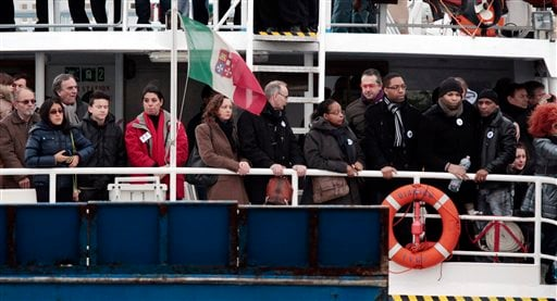 © Relatives of the 32 victims of the Costa Concordia shipwreck, aboard a ferry approach the ship off the Tuscan Island Isola del Giglio, Italy, Sunday, Jan. 13, 2013.