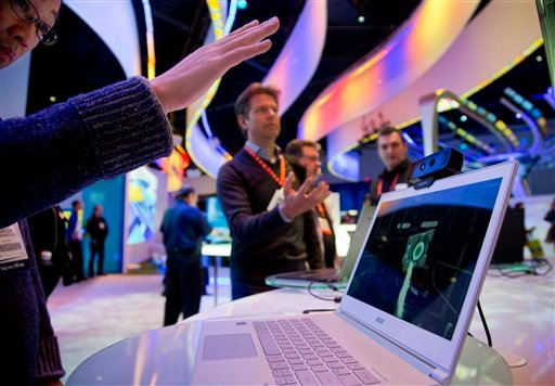 © Convention attendees test out Intel's Creative Interactive Gesture Camera development kit at the Consumer Electronics Show, Friday, Jan. 11, 2013, in Las Vegas.