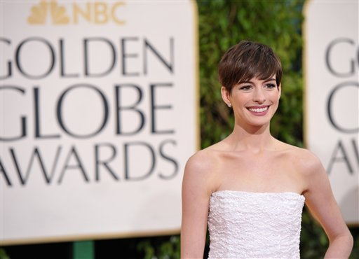 © Actress Anne Hathaway arrives at the 70th Annual Golden Globe Awards at the Beverly Hilton Hotel on Sunday Jan. 13, 2013, in Beverly Hills, Calif. (Photo by John Shearer/Invision/AP)
