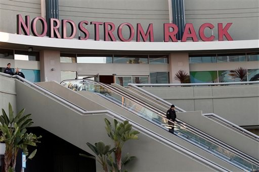 © Police secure the scene at the Nordstrom Rack store at Westchester Mall in Los Angeles, where LAPD SWAT officers rescued 14 people who were hiding in a storage room following an armed robbery, Friday, Jan. 11, 2013.
