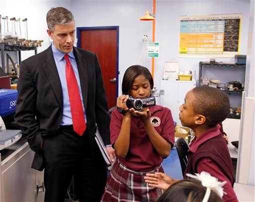 In this Friday, April 15, 2011 photo, U.S. Department of Education Secretary Arne Duncan is questioned by student Trebor Goodall, right, as he's videotaped by fellow student Faith Brown during a tour of the Charles A.