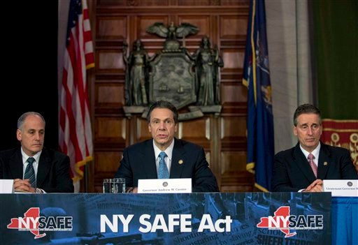 © New York Gov. Andrew Cuomo, center, speaks during a news conference announcing an agreement with legislative leaders on New York's Secure Ammunition and Firearms Enforcement Act in the Red Room at the Capitol on Monday, Jan. 14, 2013, in Albany, N.Y.