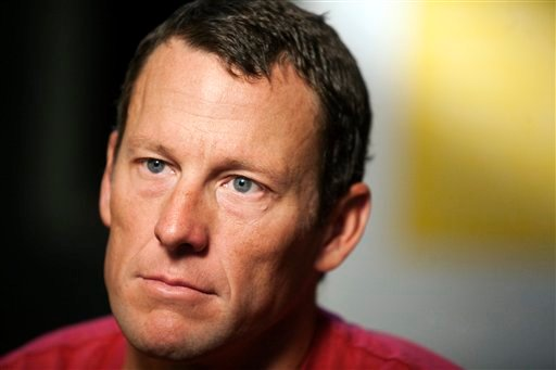 © In this Feb. 15, 2011 file photo, Lance Armstrong pauses during an interview in Austin, Texas.