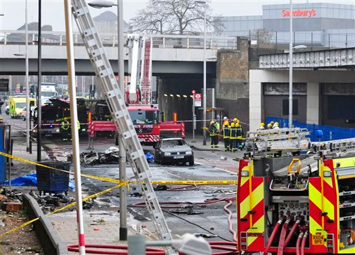 Debris lies on the ground after a helicopter crashed into a construction crane on top of St George's Wharf tower building, in London, Wednesday Jan. 16, 2013. (AP Photo/Vince Pol)