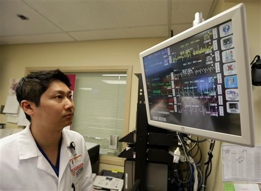 In this Monday, Jan. 14, 2013 photo, Dr. Steve Sun looks over a heart monitor display in the emergency room at St. Mary's Medical Center in San Francisco. (AP Photo/Eric Risberg)