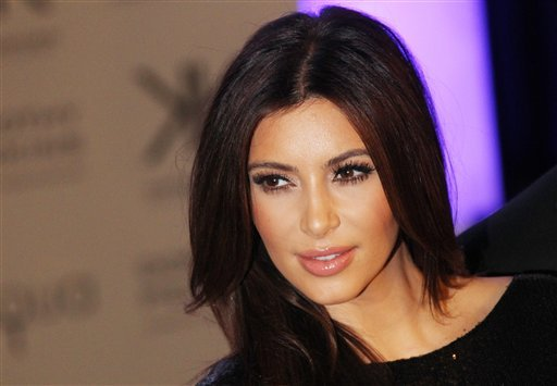 FILE - This Nov. 8, 2012 file photo shows Kim Kardashian at the Kardashian Kollection UK Launch at Acqua Club in central London.
