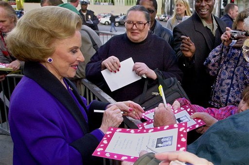 "FILE - In this Feb. 14, 2001 file photo, ""Dear Abby"" advice columnist Pauline Friedman Phillips, 82, known to millions of readers as Abigail van Buren, signs autographs for some of dozens of fans after the dedication of a ""Dear Abby"" star on the Hollywood"