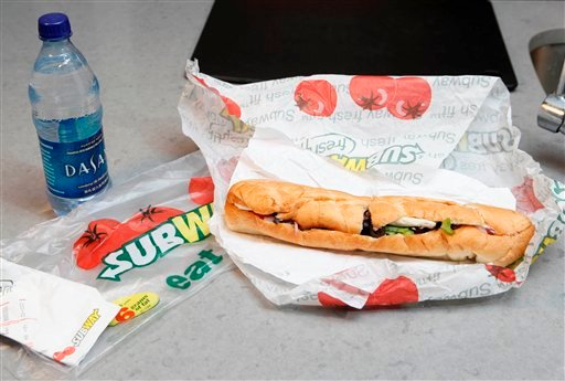 FILE - This Aug. 11, 2009, file photo, shows a chicken breast sandwich and water from subway on a kitchen counter in New York. (AP Photo/Seth Wenig, File)