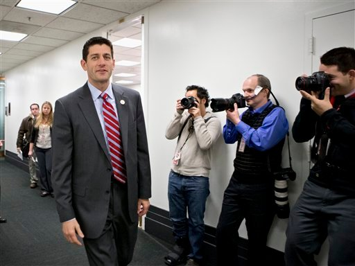 FILE - This Nov. 28, 2012 file photo shows House Budget Committee Chairman Rep. Paul Ryan, R-Wis. walking on Capitol Hill in Washington.  (AP Photo/J. Scott Applewhite, File)