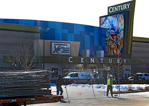 © Workers with American Fence remove the fence from around the Century theater in Aurora, Colo., on Thursday, Jan. 17, 2013.