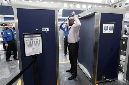 FILE - In this Monday, March 10, 2010 file photo, volunteers pass through the first full body scanner, which uses backscatter technology, installed at O'Hare International Airport in Chicago. (AP Photo/M. Spencer Green, File)