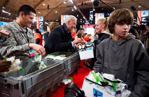© Vice President Joe Biden, center, fills care kits with necessities for deployed U.S. service members, wounded warriors, veterans and first responders, joining the National Day of Service as part of the 57th presidential inauguration in Washington.