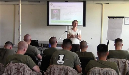 © This 2011 image provided by Robert Skidmore shows Dr. Elizabeth Stanley, instructing a class of U.S. Marines at Camp Pendleton, Calif.