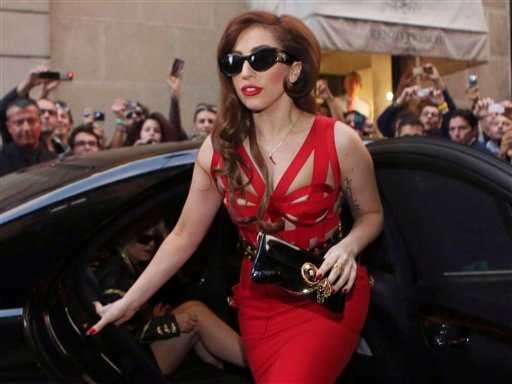 © This Oct. 1, 2012 file photo shows Lady Gaga arriving at the Versace atelier in Milan, Italy.