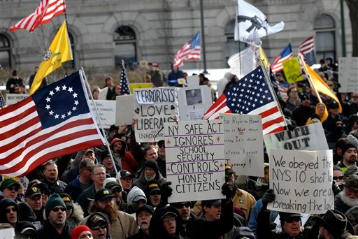 © Demonstrators rally outside the Capitol in Albany, N.Y., on Saturday, Jan. 19, 2013 to assert their right to own firearms and to denounce recent gun-control efforts.