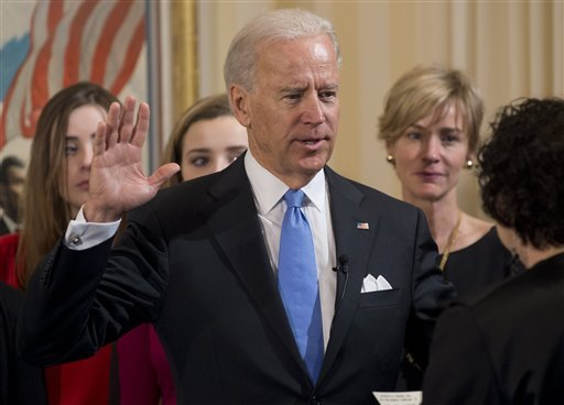 © Vice President Joe Biden takes the oath of office during the 57th Presidential Inauguration official swearing-in ceremony at the Naval Observatory on Sunday, January 20, 2013 in Washington.