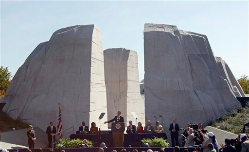 © In this Oct. 16, 2011, file photo, President Barack Obama speaks at the dedication of the Martin Luther King Jr. Memorial in Washington. Monday's inaugural may be Obama's big day, but Martin Luther King Jr. will loom large over the festivities.