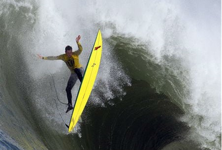 © In this file photo from Saturday, Feb. 13, 2010, Ion Banner loses control on a giant wave during the Mavericks surfing contest in Half Moon Bay, Calif.