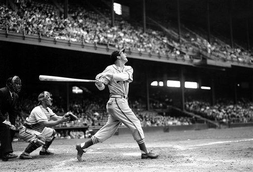 ©  In this May 22, 1946 file photo, St. Louis Cardinals' Stan Musial bats against the Philadelphia Phillies during a baseball game at Shibe Park in Philadelphia, Pa.