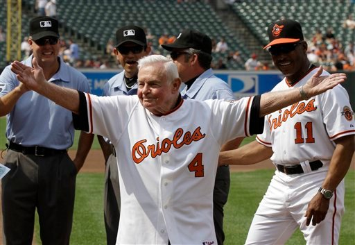 ©  In this Saturday, June 26, 2010 file photo, former Baltimore Orioles manager Earl Weaver (4) waves to the crowd after taking the lineup card out before the start of a baseball game between the Orioles and Washington Nationals, in Baltimore.