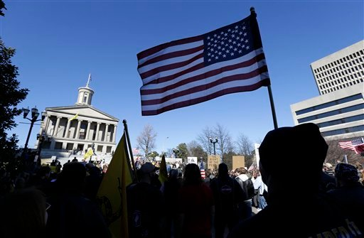© Gun rights advocates demonstrate near the Capitol building on Saturday, Jan. 19, 2013, in Nashville,