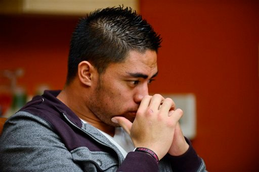 © In a photo provided by ESPN, Notre Dame linebacker Manti Te'o pauses during an interview with ESPN on Friday, Jan. 18, 2013, in Bradenton, Fla.