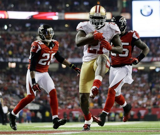 © San Francisco 49ers' Frank Gore (21) breaks away for a nine-yard touchdown run during the second half of the NFL football NFC Championship game against the San Francisco 49ers Sunday, Jan. 20, 2013, in Atlanta.