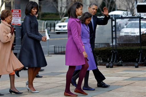  President Barack Obama, accompanied by his daughters Sasha and Malia, first lady Michelle Obama and mother-in-law Marian Robinson, waves as they arrive at St. John's Church in Washington, Monday, Jan. 21, 2013.