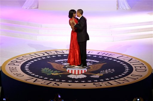 © President Barack Obama and first lady Michelle Obama dance during the Commander-In-Chief Inaugural ball at the Washington Convention Center during the 57th Presidential Inauguration Monday, Jan. 21, 2013 in Washington.