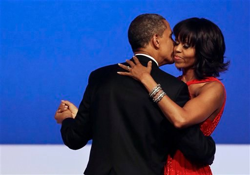 President Barack Obama kisses first lady Michelle Obama during their dance at the Commander-in-Chief Inaugural Ball at the Washington Convention Center during the 57th Presidential Inauguration Jan. 21, 2013. (AP Photo/Jacquelyn Martin)